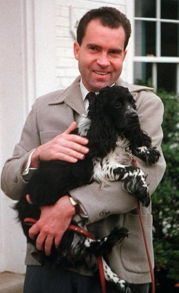 """Vice President Richard Nixon is seen with his dog """"Checkers,"""""""