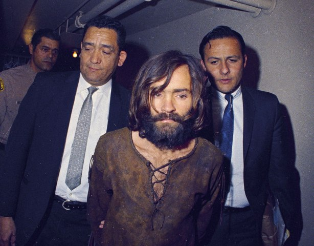 Charles Manson being escorted to his arraignment on conspiracy-murder charges in connection with the Sharon Tate murder case, in Los Angeles, in 1970.