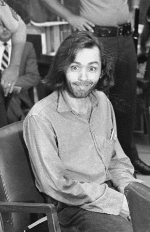 Charles Manson sticks his tongue out at photographers as he appears in a Santa Monica, Calif., courtroom on June 25, 1970.