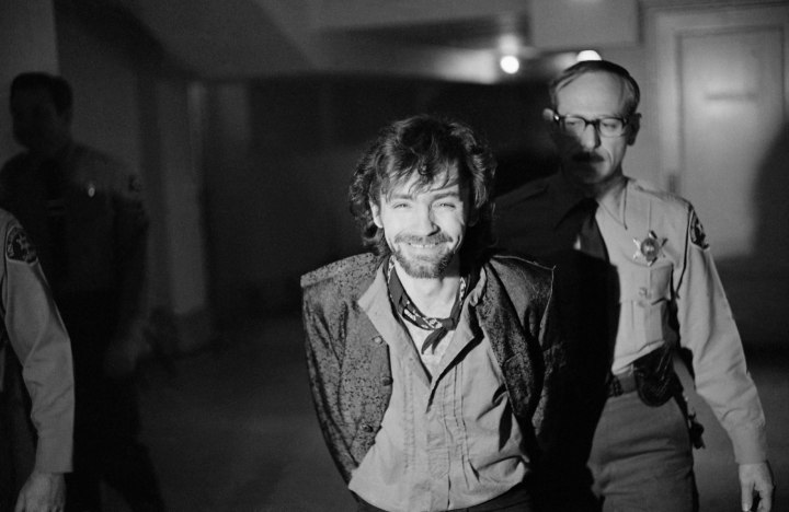 A smiling Charles Manson goes to lunch after an outbreak in court that resulted in his ejection, along with three women co-defendants, from the Tate murder trial, on Dec. 21, 1970.