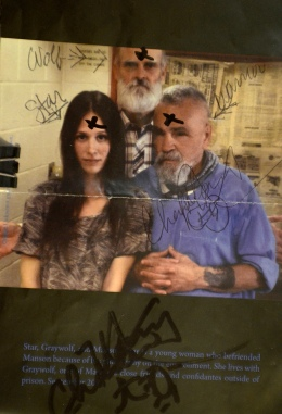 An autographed photo of Charles Manson, far right, and friends Graywolf, center, and Star, left on July 31, 2013.