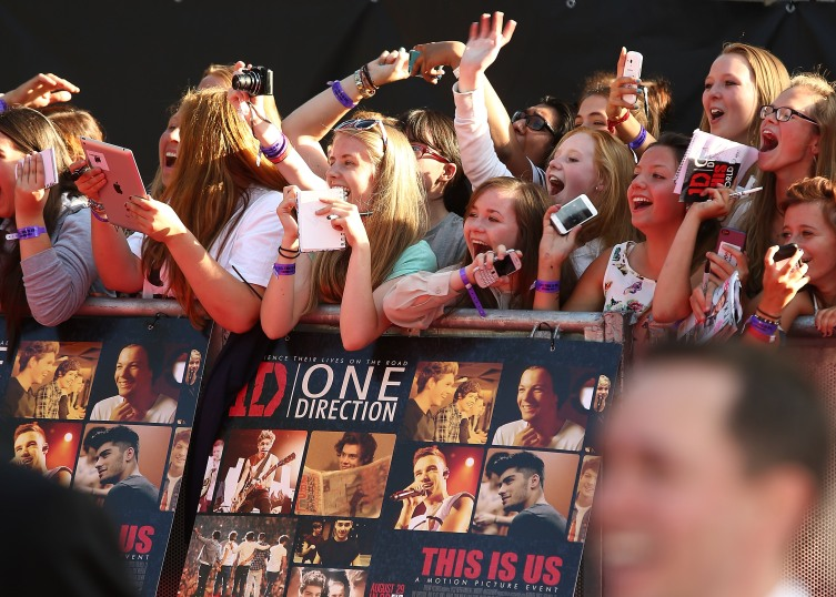One Direction fans attend the World Premiere of 'One Direction: This Is Us' at Empire Leicester Square on Aug. 20, 2013 in London.
