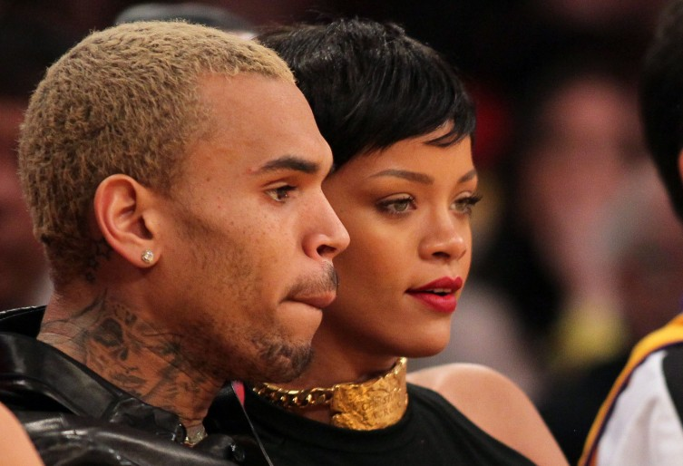 From left: Chris Brown and Rihanna attend the NBA game between the New York Knicks and the Los Angeles Lakers at Staples Center on Dec. 25, 2012 in Los Angeles.