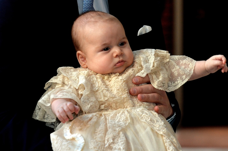 Britain's Prince William, Duke of Cambridge holds his son, Prince George of Cambridge, at Chapel Royal in St. James's Palace in central London for the christening of the baby on Oct. 23, 2013.