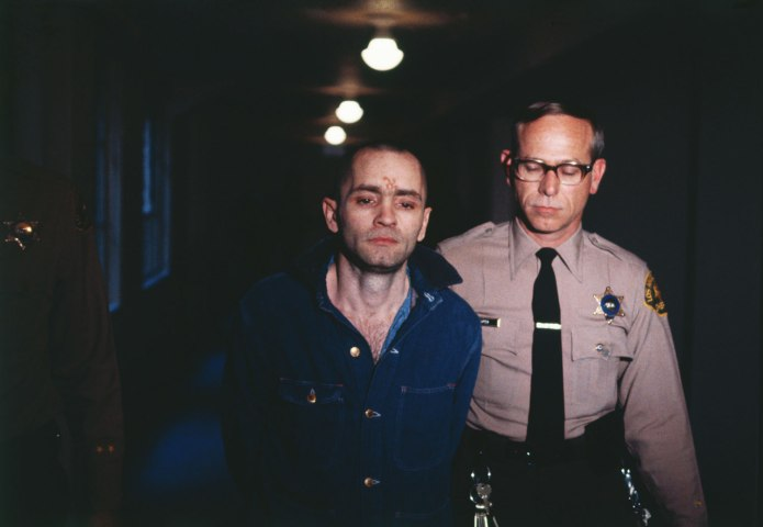 Charles Manson, convicted murderer, is led back into the courtroom to hear the penalty he and this three female followers must pay for the Tate-LaBianca murders of August 1969, on March 29, 1971.