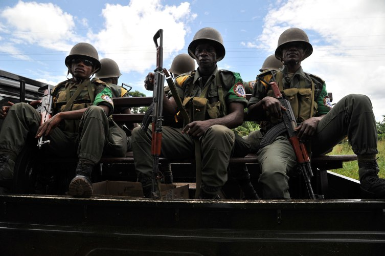 Soldiers from the Central African Multinational Force (FOMAC) sit in a vehicle as they patrol a road in a village near Bangui on October 6, 2013 during an operation to secure the disarmament of former Seleka rebels.