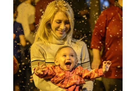 Jesee Barton and her nine-month-old Lexie Scott on Dec. 03, 2013, in downtown Northport, Ala.