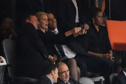 Danish Prime Minister Helle Thorning-Schmidt poses for a photo with U.S. President Barack Obama (R) and U.K. Prime Minister David Cameron during the memorial service of former South African President Nelson Mandela at FNB Stadium in Johannesburg on Dec. 10.