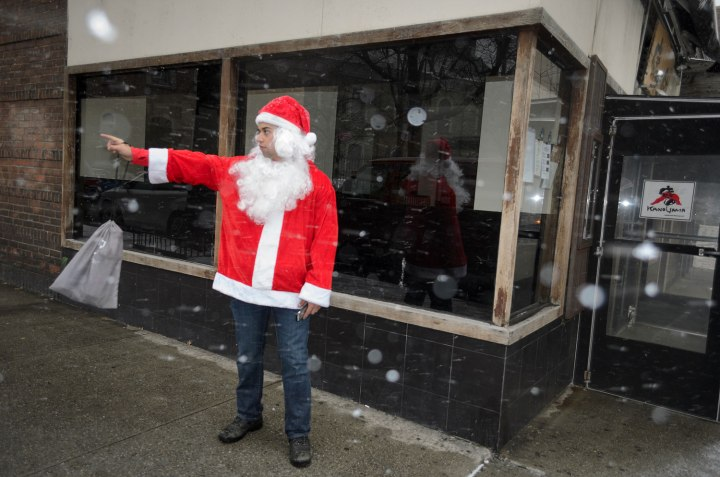 A SantaCon participant points the way to the next bar in the East Village.