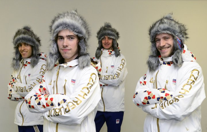 Czech ski jumpers, left to right, Jan Matura, Antonin Hajek, Lukas Hlava and Roman Koudelka present the new olympic suit for the Sochi Olympic Winter Games  on Jan. 20, 2014 in Prague.