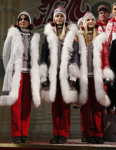 Russian athletes pose for the press during the presentation of the uniforms for the Russian national Olympic team for the upcoming 2014 Winter Olympic Games in Sochi, in Moscow, Russia, 26 December 2013.