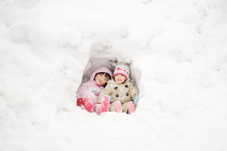 sisters playing with snow