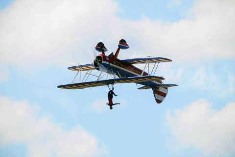 "U.S. pilot Greg Shelton and wing walker Ashley Battles performs a stunt called Wing Walker during the ""Ilopango Air Show 2014"", in the air base of Ilopango city, in San Salvador, El Salvador, on Jan. 26, 2014."