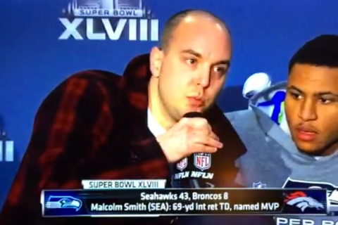 Brooklyn resident Matthew Mills, 30, interrupts MVP Malcolm Smith during the Super Bowl postgame press conference to talk about how the U.S. government perpetrated 9/11.