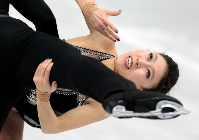 Pang Qing and Tong Jian of China compete in the pairs short program figure skating competition at the Iceberg Skating Palace.