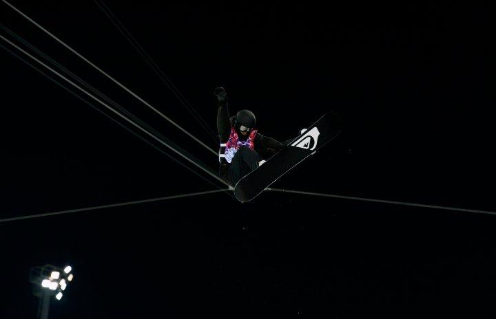 Switzerland's Iouri Podladtchikov performs a jump during the men's snowboard halfpipe semi-final event Feb. 11, 2014.
