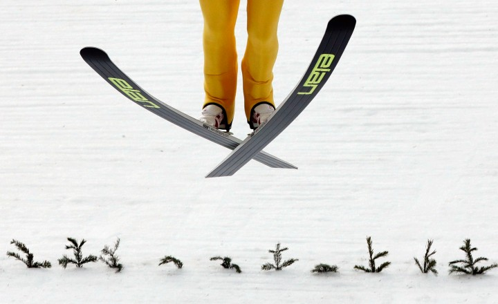 Finland's Mikke Leinonen lands during a men's nordic combined training session at the 2014 Winter Olympics, Tuesday, Feb. 11, 2014.